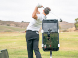 iphone on stand pointed at golfer