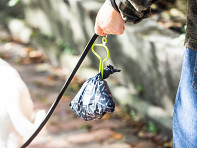 the dooloop: Hands-Free Dog Waste Bag Holder